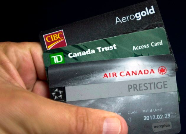 Cards from CIBC, TD Bank and Aeroplan are shown June 27, 2013 in