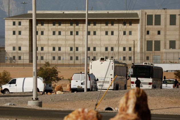 Immigration and Customs Enforcement (ICE) detainees arrive at a federal prison in Victorville,
