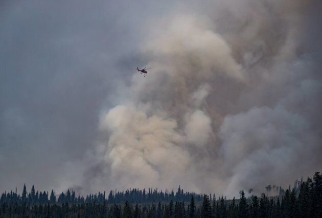 Large plumes of smoke rise from a wildfire near Fraser Lake, B.C. on August 15,