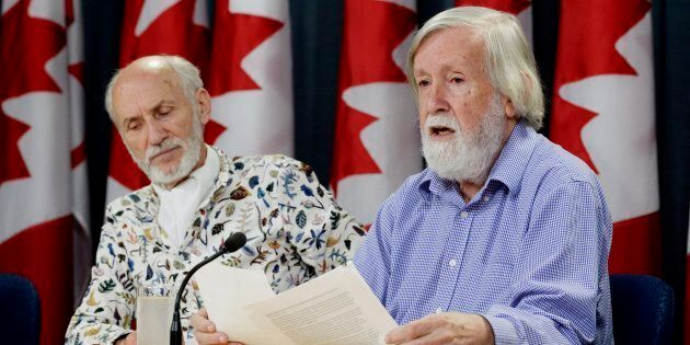 Gilles Provost, left, listens as President of the Canadian Coalition for Nuclear Responsibility Gordon...