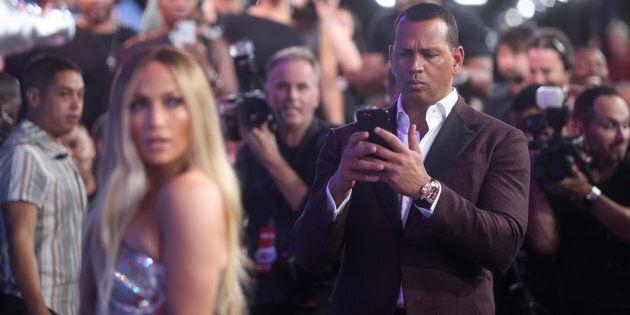 Alex Rodriguez proudly photographs girlfriend Jennifer Lopez at the 2018 MTV VMAs on Aug. 20,