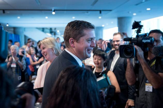 Conservative leader Andrew Scheer is greeted by supporters at the Party's national convention in Halifax on Aug. 23, 2018.
