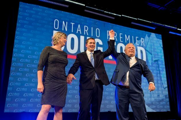 Ontario Premier Doug Ford celebrates on stage with Conservative leader Andrew Scheer and wife Jill Scheer...
