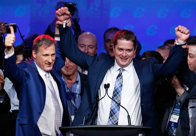 Maxime Bernier celebrates with Andrew Scheer after Scheer's leadership win during the Conservative Party of Canada leadership convention in Toronto on May 27, 2017.