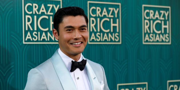 Actor Henry Golding poses at the Los Angeles premiere for