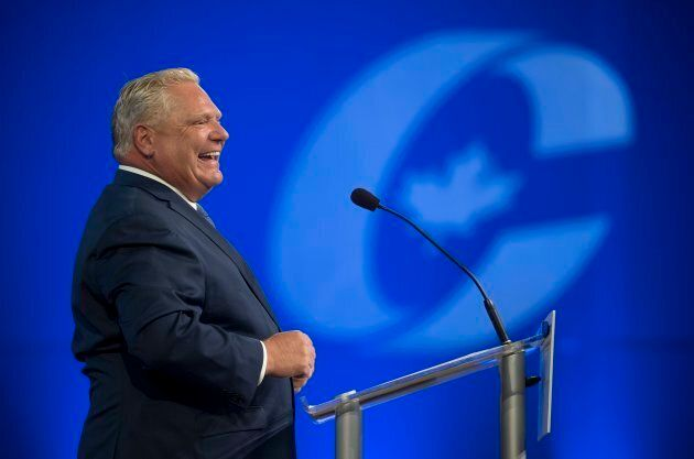 Ontario Premier Doug Ford laughs while speaking at the Conservative national convention in Halifax on