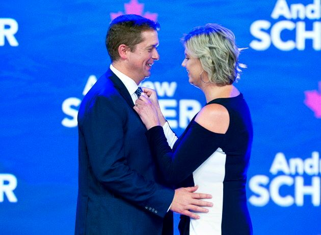 Andrew Scheer gets some help with his tie from his wife Jill before his