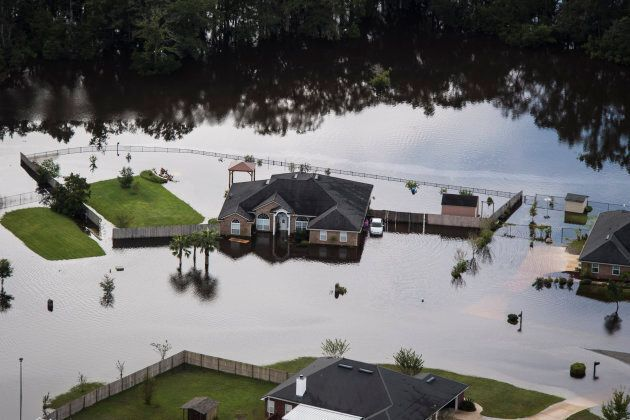 Houses surrounded by flood water in the aftermath of Hurricane Irma in Callahan, Fla., Tues. Sept 12,