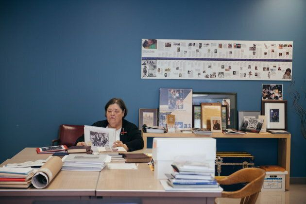 Nancy Hurn leafs through binders of photos from Anglican residential schools. Hurn help families who...