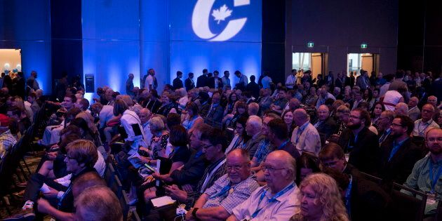 Supporters attend the opening ceremony of the Conservative national convention in Halifax on August 23,