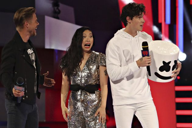 Awkwafina reacts to Shawn Mendes in a Marshmello costume onstage at the iHeartRadio MuchMusic Video