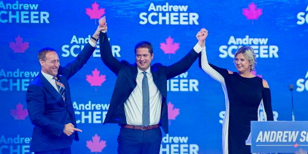 Conservative Leader Andrew Scheer, accompanied by his wife Jill, is introduced by former Conservative cabinet minister Peter MacKay, left, at the party's national policy convention in Halifax on Aug. 24, 2018.