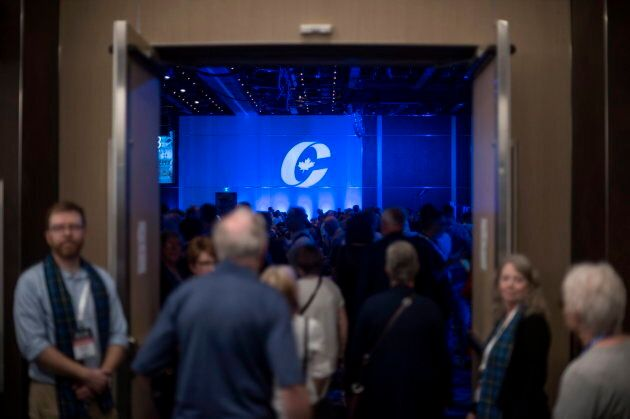 Supporters enter the auditorium for the opening ceremony at the Conservative national convention in Halifax on Aug. 23, 2018.