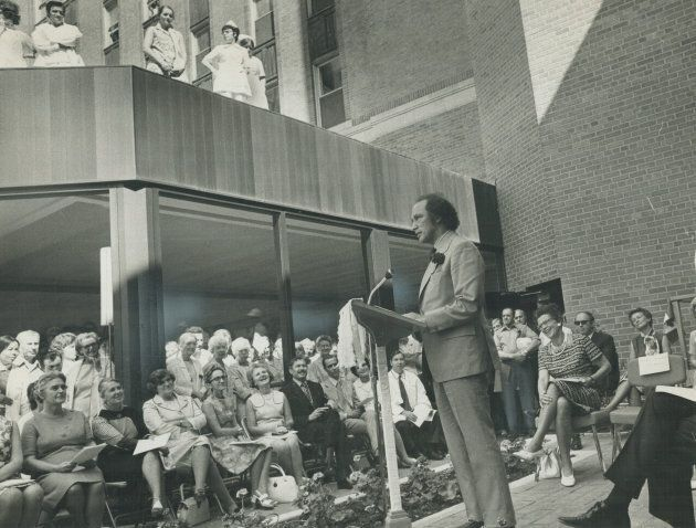 While demonstrators shouted from across the street, almost drowning out his address with their demands for free abortions; Prime Minister Pierre Trudeau draws laughter from his audience at the opening of a new $16 million wing at Women's College Hospital in Toronto on June 23, 1971.