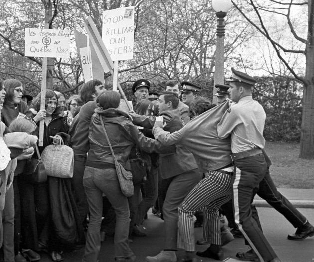 Members of Abortion Caravan demonstrate on Parliament Hill on May 9, 1970 as police try to control the