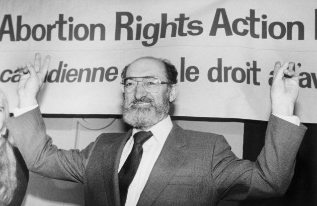 Dr. Henry Morgentaler raises his arms in victory at a news conference in Toronto, Ont., Jan. 28, 1988.