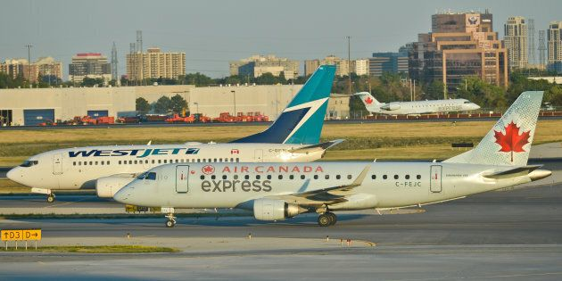 Air Canada and WestJet planes taxiing at Toronto Pearson International Airport, Wed. July 20, 2016. Many...
