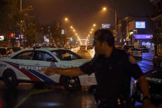Toronto Police officers work on Danforth Street, where a shooting took place in Toronto, Ont.