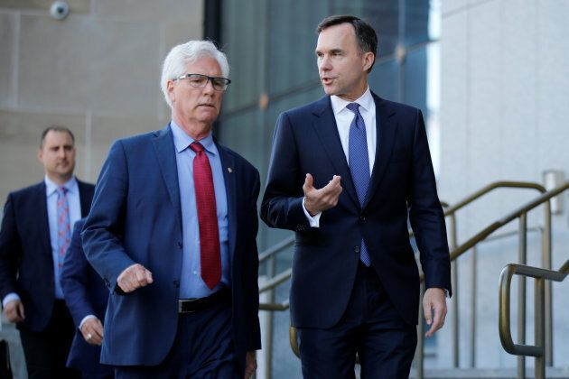 International Trade Diversification Minister Jim Carr and Finance Minister Bill Morneau walk to a news...