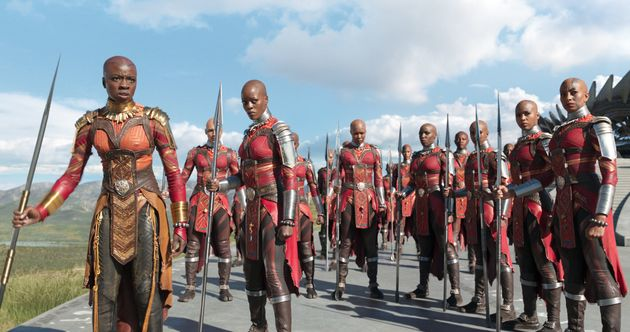 L to R: Okoye (Danai Gurira) and Ayo (Florence Kasumba) with the Dora Milaje in 'Black