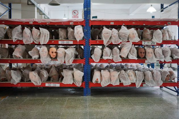 Various doll heads covered with dust bags are seen on shelves at the WMDOLL factory in Guangdong, China...