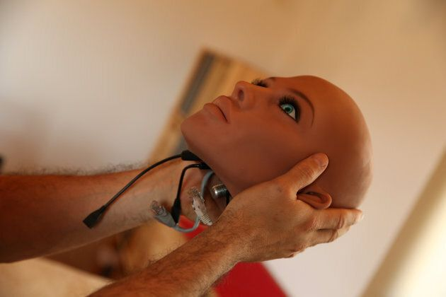 Catalan nanotechnology engineer Sergi Santos holds the head of Samantha, a sex doll packed with artificial...