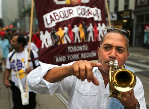 A demonstrator marching at the Annual Labour Day parade in Toronto on Sept. 1, 2014.
