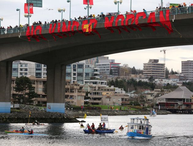 Protesters against the proposed expansion of the Trans Mountain pipeline cross a bridge in Vancouver on Nov. 19, 2016.