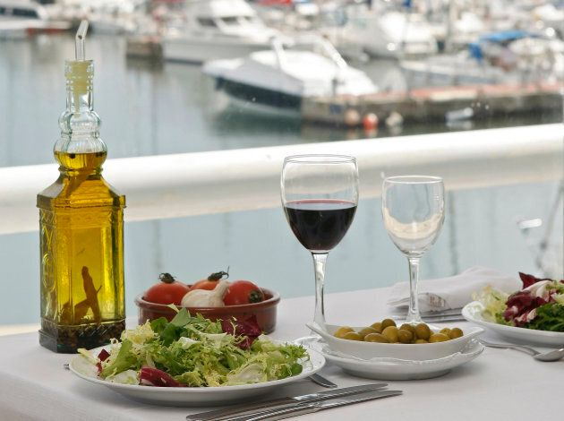 Food is seen on a table at a restaurant at the port of El Masnou, near