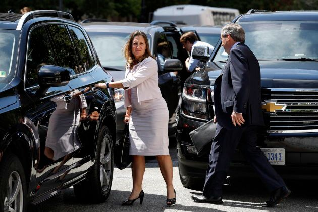 Foreign Affairs Minister Chrystia Freeland walks to a car during a break in trade talk negotiations from...