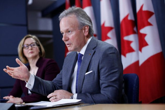 Bank of Canada Governor Stephen Poloz speaks during a news conference with Senior Deputy Governor Carolyn Wilkins in Ottawa, April 18. Poloz says Canada's flattening yield curve is not a problem, at least this time around.