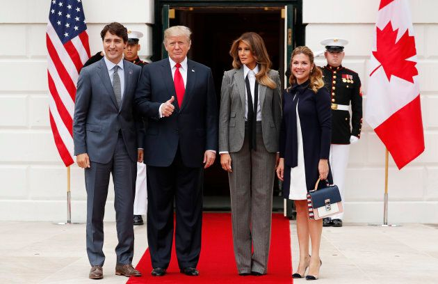 U.S. President Donald Trump gives a thumbs up as he and first lady Melania Trump welcome Prime Minister...