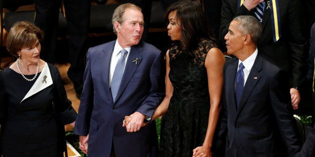 Former President George W. Bush and former first lady Michelle Obama have what appears to be a genuine bond, sharing several heartwarming moments at recent public events. Here they join hands during a memorial service in Dallas, Texas on July 12, 2016.