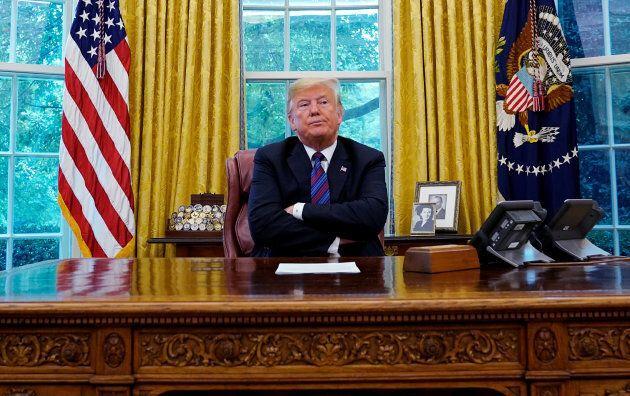 U.S. President Donald Trump talks with Mexican President Enrique Pena Nieto on Aug. 27,