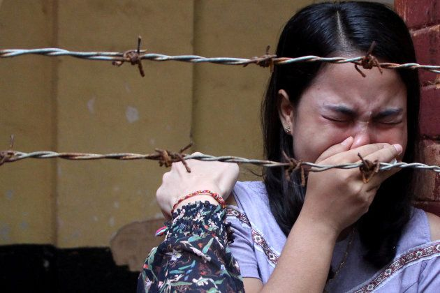 Chit Suu Win, wife of Reuters journalist Kyaw Soe Oo, reacts after listening to the the verdict in Yangon, Myanmar on September 3, 2018.
