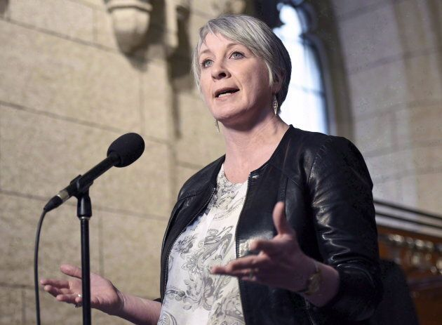 Minister of Employment, Workforce Development and Labour Patty Hajdu speaks to reporters during a weekend...
