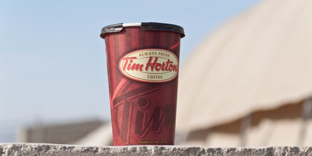 The parent company of Tim Hortons seized ownership of four locations from a restaurant owner heading...