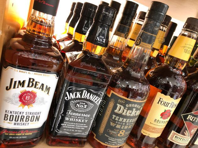 A bottle of Jack Daniels is shown for sale among other brands in the liquor section of a food market...