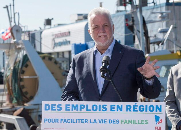 Quebec Liberal Leader Philippe Couillard responds to reporters questions during a news conference on...