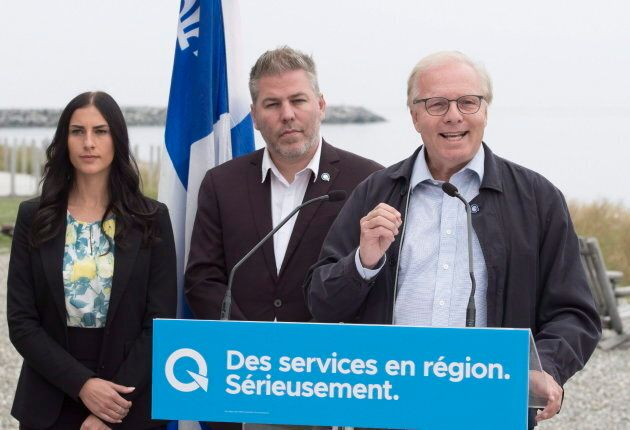 Parti Quebecois Leader Jean-Francois Lisee, right, speaks at a news conference on Sept. 3, 2018 in Matane