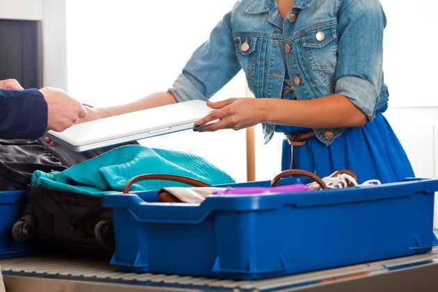 Airport Security Bins Could Be The Reason People Get Sick While Travelling: