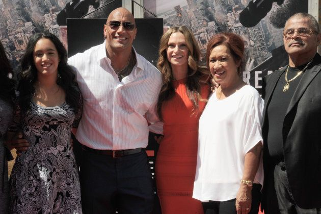 Dwayne 'The Rock' Johnson poses with his daughter Simone Alexandra Johnson, his partner Lauren Hashian,...