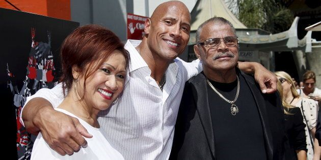 Dwayne 'The Rock' Johnson poses with his mother Ata Johnson and father Rocky Johnson at the TCL Chinese...