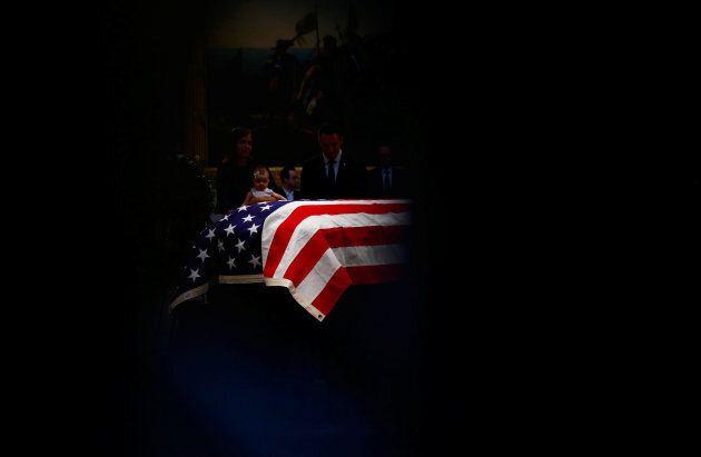 The body of late United States Senator John McCain lies inside the U.S. Capitol Rotunda in Washington,...