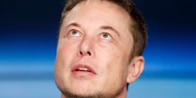 Tesla CEO and SpaceX founder Elon Musk pauses at a press conference following the first launch of a SpaceX...