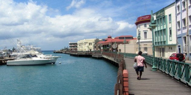 Waterfront walkway in Bridgetown, Barbados.Keen-eyed Canadians may notice the CIBC building in the background; in fact Canadian-owned banks seem to outnumber non-Canadian banks by a wide margin in Barbados. But they still manage to charge you a preposterously high service fee to use your Canadian bank card there.
