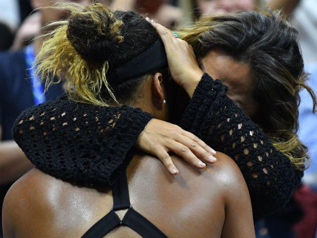 Naomi Osaka and her mother Tamaki Osaka embrace after Osaka's victory.