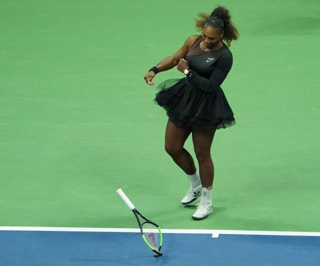 Serena Williams smashes her racket during the U.S.