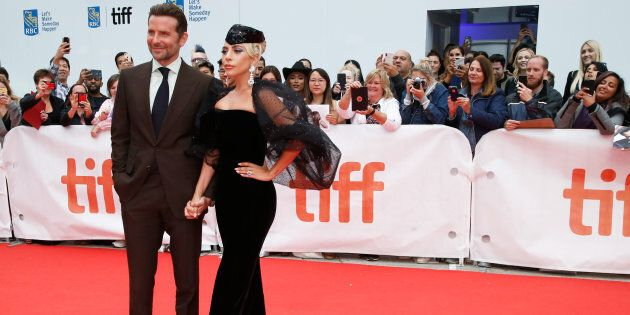 Bradley Cooper poses with Lady Gaga at the world premiere