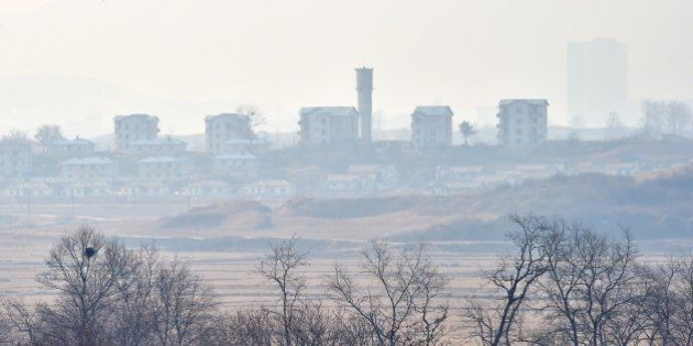 North Korea's propaganda village of Gijungdong is seen from a South Korean military check point of the...